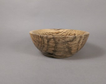 Spinning bowl made from weeping cherry. #2 of 4. Stabilized wood bowl.