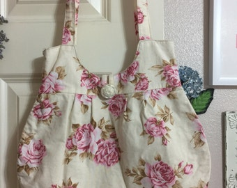 Shabby chic/vintage style with pink flowers and beige background shoulder purse.