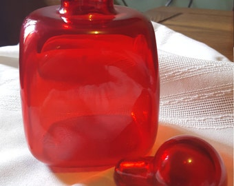 Red glass square small decanter/bottle with glass stopper.