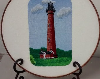 Detailed embroidered lighthouse wall hanging
