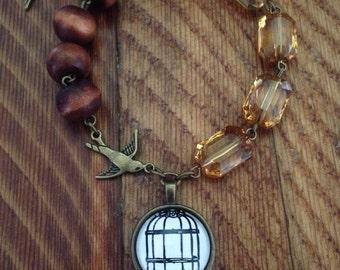 Swallow and birdcage bracelet