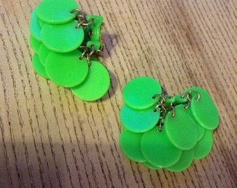 Clip on green plastic earrings