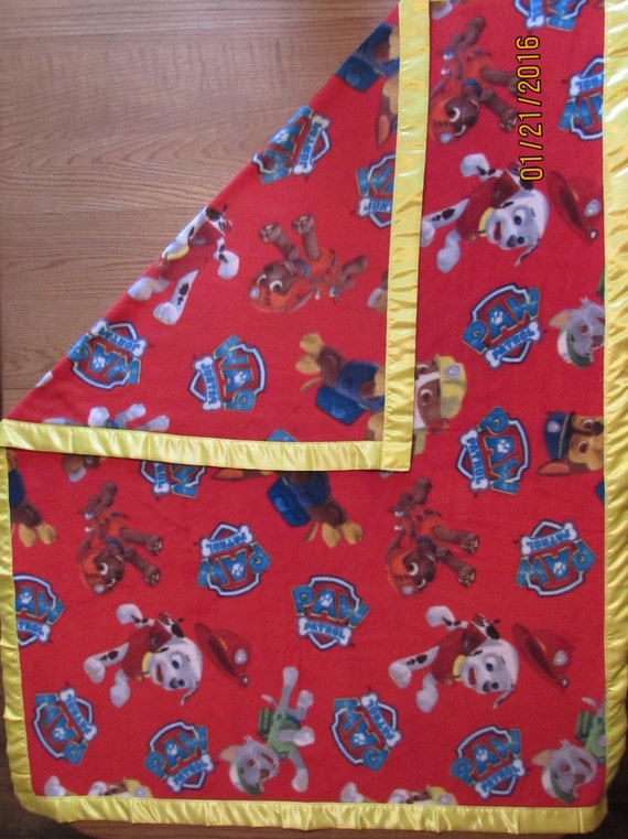 Paw Patrol fleece blanket with yellow satin edge sizes baby, toddler, oversize toddler and twin