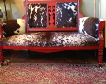 1890 Love seat that I reupolstered with cowhide.