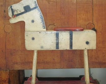 Primitive Wooden Painted Toy Horse on Wheels
