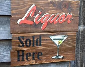 Liquor Sold Here rustic pallet wood bar sign