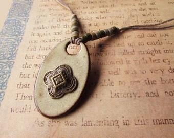 Earthy brass & ceramic necklace