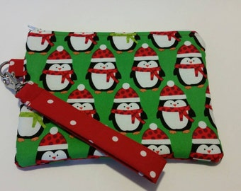 Holiday penguins on a wristlet ready for fun.
