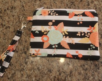 Black and coral flower/striped wristlet/clutch