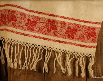 Vintage linen damask towel with red vine patterns and fringes. Around 1920's