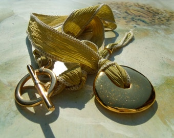Greek ceramic disc gold on the Silk Ribbon necklace