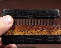 Comb in the case of stained oak 4.000 years old, 40 years old bog oak