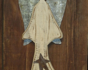 Primitive Wooden Angel with rusty tin wings. Use her indoors or out. Rustic and folk Art descibe her perfectly.