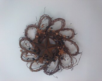 This is a12 inch beautifully decorated grapevine wreath! It has the rustic star and the berry ring to accent your country home!