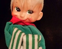 1950s Large White Haired Freckle Face Knee Hugging Musical Elf