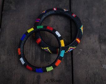 Summer beaded bracelet of matte black beads.