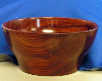 Stunningly beautiful hand turned Padauk bowl which displays brilliant color and is a great center piece art object.