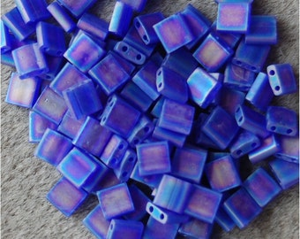 MIYUKI TILA Beads, 2 Hole, 5mm Square, Matte Transparent Cobalt AB, sold in units of approx 10gms.