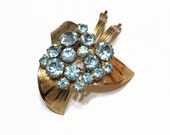 VALENTINE DISCOUNT 10 Blue Rhinestone Brooch Pin, Textured Goldtone, Flower, Triangular, German, 1930s