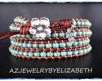 Seed Bead And Leather Wrap Bracelet Beaded With Turquoise Seed Bead And A flower Button.