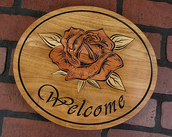 Rose welcome sign carved into maple wood oval x