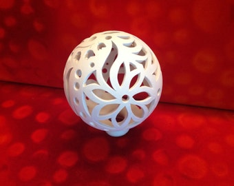 Art deco rose ball of white clay to the light
