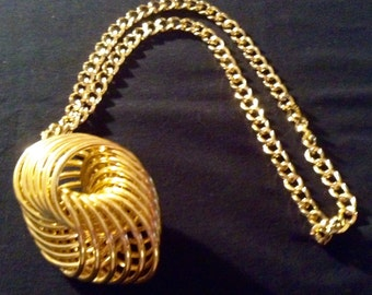 Mid century gold tone pendant and chain necklace.