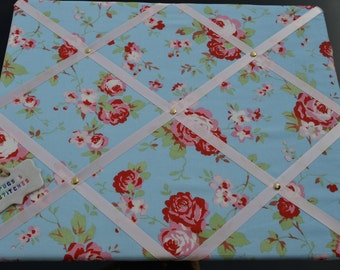 HANDMADE fabric covered memo board. 18x14 inch in lovely blue rose fabric finished in pink ribbon