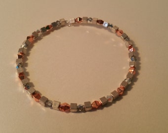 Silver and rose gold beaded bangle.