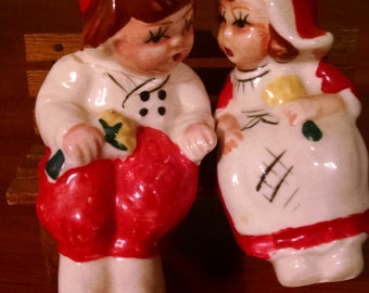 vintage dutch boy and girl salt and pepper on bench