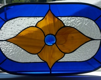oval antique looking stained glass item