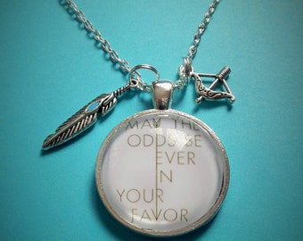 "HUNGER GAMES - ""may the odds be ever in your favor"" quote inspired 25mm glass dome - fan gift -"