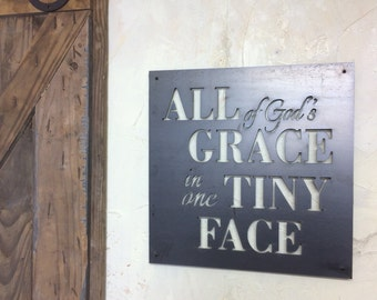 All of God's grace in one Tiny Face! Steel wall art