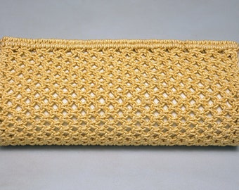 Gold coloured clutch bag