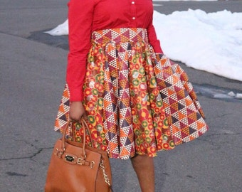 Ankara/African Midi Flare skirt with two pocket and a belt.all sizes available