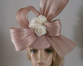 dusky pink perching beret & silk abaca bows adorned with ivory silk flowers,swarovski crystals and pearls.