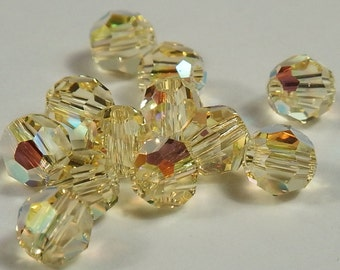 Close Out! Jonquil Yellow Swarvoski Crystal, 4 mm, AB,  OR Reg. Finish, Round, Pkg of 12