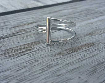 Handmade silver tight ring around wire square bar