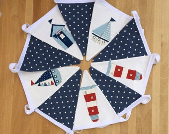 Marine Bunting. Blue and white polka dot flags inbetween flags using beach huts, boats and light houses for a sea side themed bunting