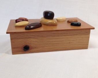 Handmade keepsake or jewelry box made with repurposed oak with sculpted wood rocks on lid.