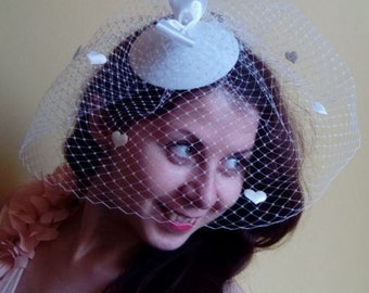 White hat with a veil and hearts