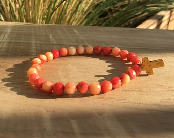 Red and Pink Dyed Coral Bracelet with Gold Hammered Cross