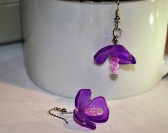 purple lucite flower earrings on a wire hook