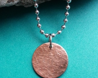 Glow: Hammered and brushed copper disc pendant