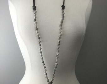 Hand knotted beaded necklace with leather adjustable ties and soldered buddha pendant