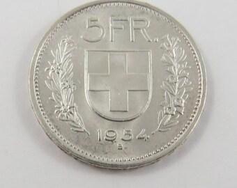 Switzerland 1954 B Silver 5 Franc Coin.