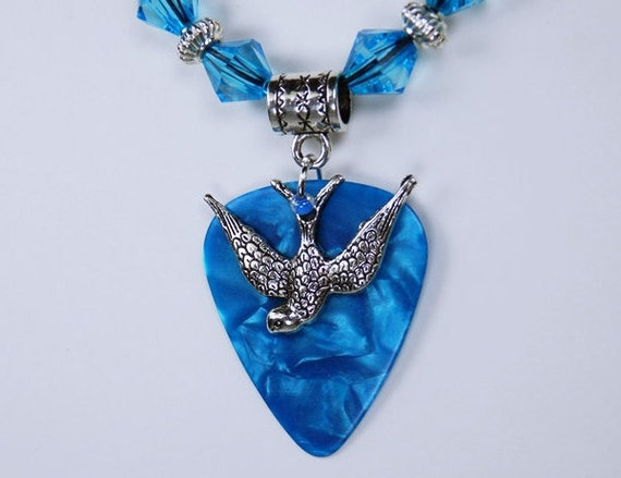 Necklace pick in blue mottled with silver-colored swallow bird pendant on black leather strap unique jewelry Beads light blue
