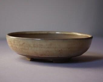 Shallow literati style bonsai pot in a speckled beige gloss glaze