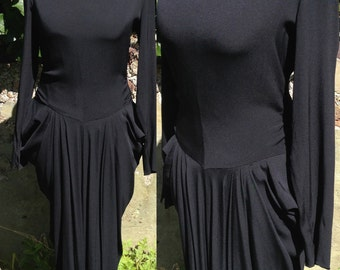 Vintage 1940s dress in black silk crepe with dramatic sculpted side pleats Hollywood glamour