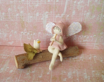 Miniature Fairy and duck on log